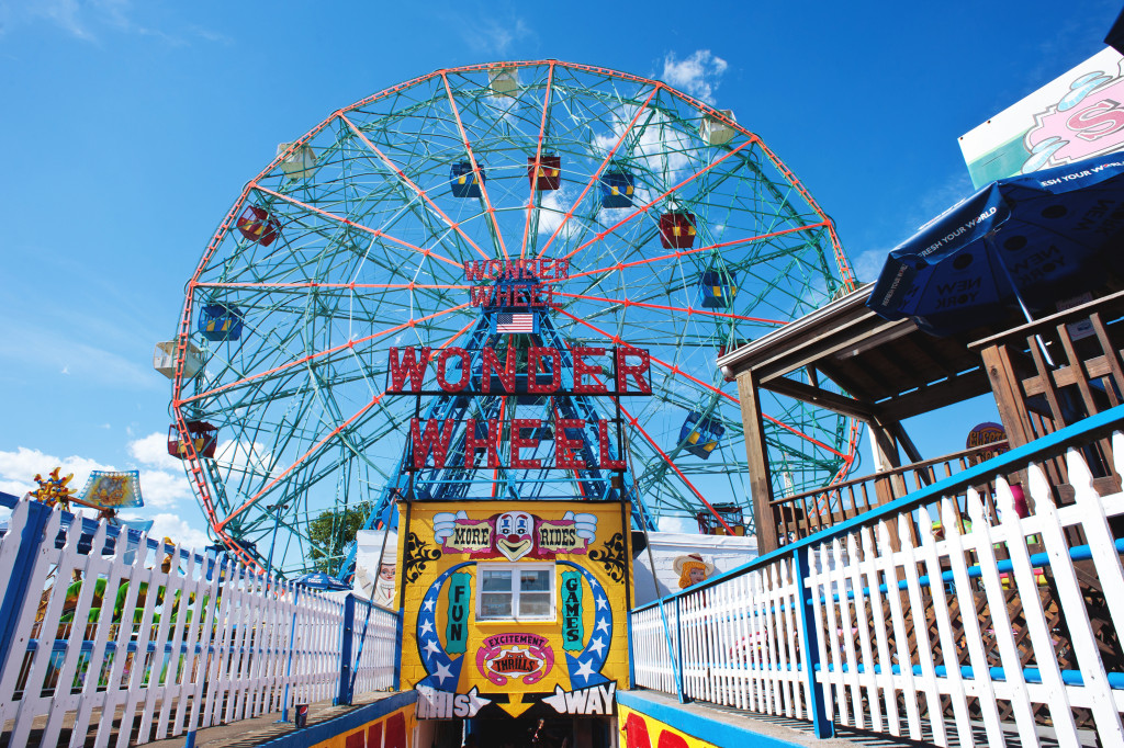 NEW YORK - JUNE 27: Coney Island's Wonder Wheel on June 27, 2012 in Coney Island, New York City. The Wonder Wheel holds 144 riders, stands 150 ft (46 m) tall, and weighs over 2,000 tons.